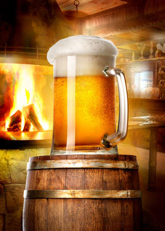 near beer: Mug of beer on wooden cask near fireplace in pub