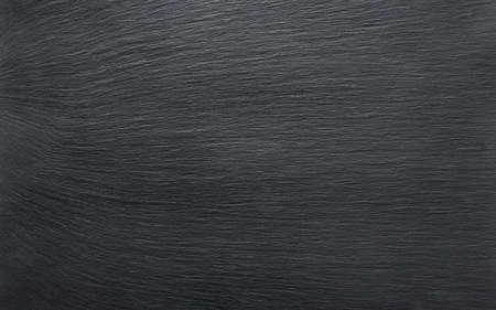 黒いスレート背景や質感の石テーブルのクローズ アップ
