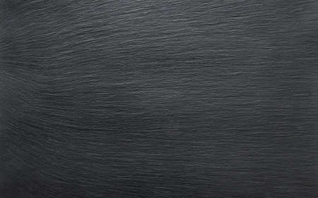 Black slate background or textured stony table close-up Stock Photo