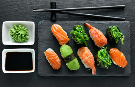 sushi plate: Slate plate with sushi set and wasabi