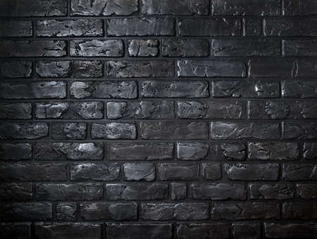 Beautiful background made of old black bricks