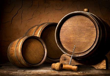 Wooden barrels and corkscrew in clay cellar Banco de Imagens - 54267471