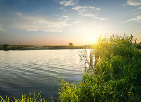 Quiet river at sunset in late summer Stock Photo