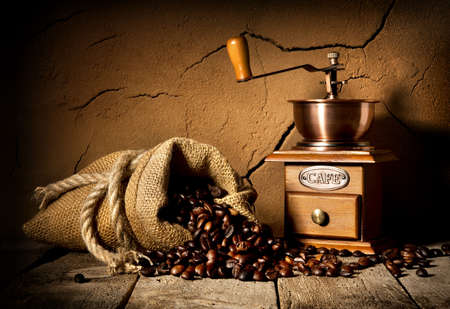 Coffee grains and mill in cellar with clay wall
