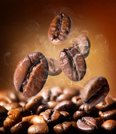 cofe: Grains of roasted coffee on an orange background Stock Photo