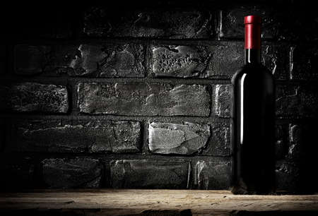 cabernet: Brick wall in cellar and bottle of cabernet