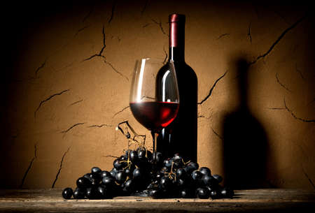glass of red wine: Wine with grape old in clay cellar