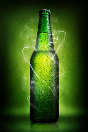 fresh concept: Green bottle of beer on a green background