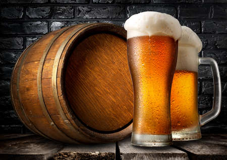 near beer: Beer and wooden keg near black brick wall Stock Photo