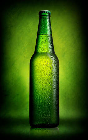 fresh concept: Delicious beer in bottle on green background Stock Photo