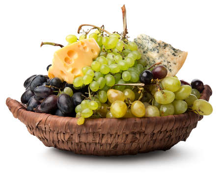 queso blanco: Cheese and grape in basket isolated on a white background