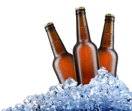 brown bottles: Brown bottles of beer in ice cubes isolated on white