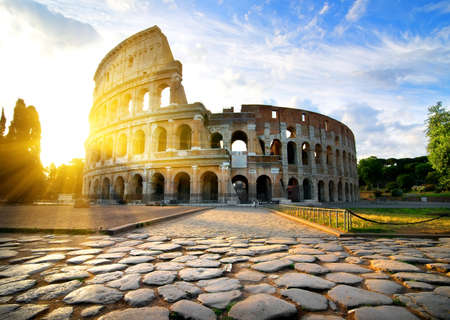 stone road: Ancient Colosseum in Rome at dawn, Italy