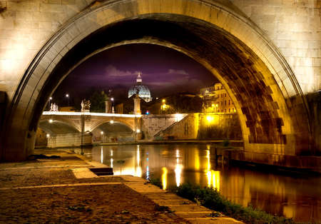 tevere: Night view on the Sant Angelo Bridge and Basilica of St. Peter in Rome, Italy