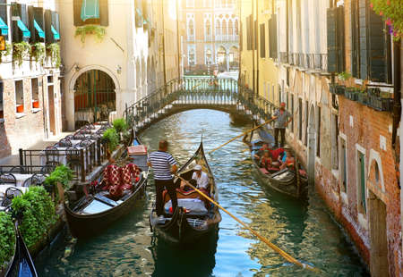 Canal in Venice between the old houses  Foto de archivo
