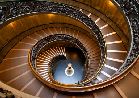 Round staircase in Vatican museum, view from above. Vatican on August 19, 2016 in Rome, Italy