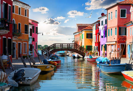 mediterranian houses: Bridge and colored houses on the street in Burano, Italy