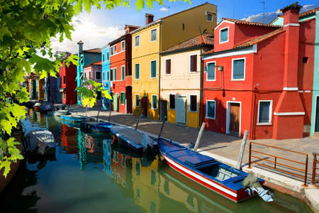 mediterranian houses: Boat and colored houses in Venetian Burano, Italy