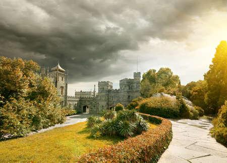 voroncov: Stone castle in the garden in autumn Stock Photo