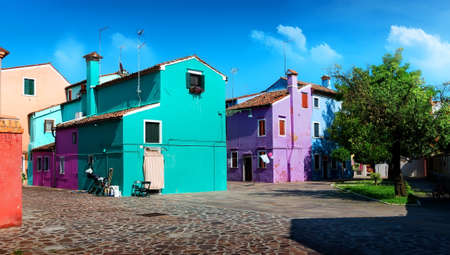 Bright colored houses on the street in Burano, Italy