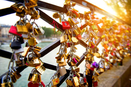 Locks of love on bridge in Paris Stockfoto