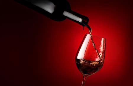 Wineglass on a red background Stok Fotoğraf