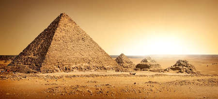 Egyptian pyramids in sand Imagens