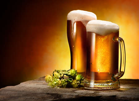 Two glasses of beer and hops