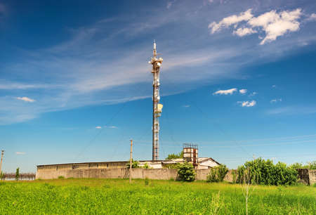 TV tower on green field Stock Photo