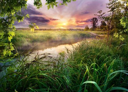 Colorful sunrise on river