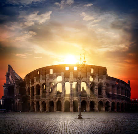 Colosseum and sunny sunrise 写真素材