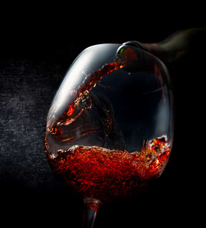 Wine pouring in wineglass