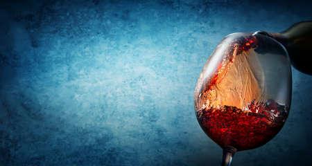 Wine on textured blue Stok Fotoğraf