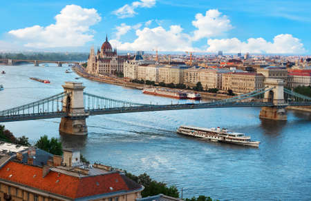 Parliament and famous bridges of Budapest at day, Hungary