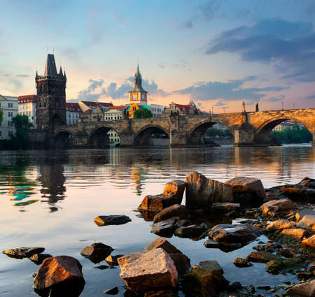Charles Bridge and stones on river Vltava  in Prague at early morning