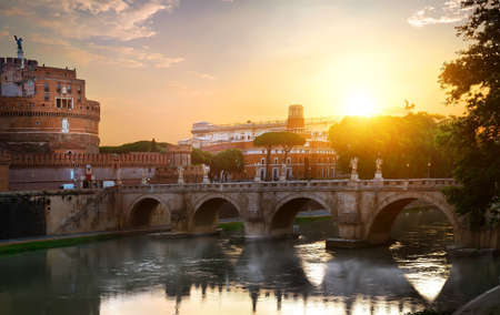 Fog on Tiber river and St Angelo bridge at sunrise, Italy Stock Photo