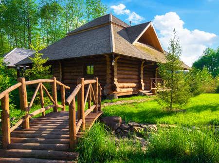 Wooden house in forest Reklamní fotografie