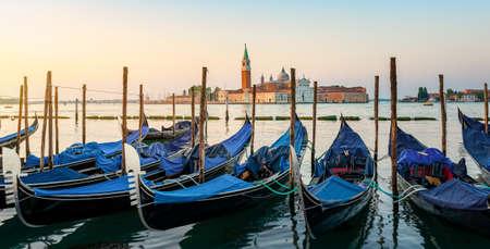Moored Gondolas at venetian sunrise in front of San Giorgio Maggiore