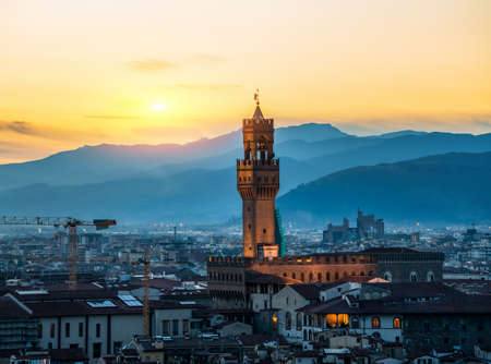 Famous tower of Florence and cityscape at sunrise
