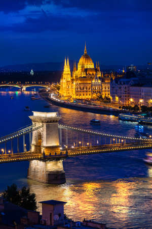 Budapest Parliament and Bridges illuminated in the evening, Hungary
