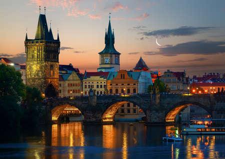 Moon over towers on Charles Bridge at sunset, Prague Stock Photo