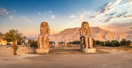 Egypt. Luxor. The Colossi of Memnon - two massive stone statues of Pharaoh Amenhotep Banco de Imagens