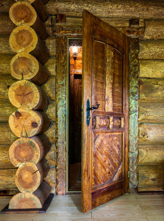 Wooden door of traditional beam country house
