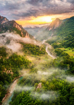 Montenegro,mountains and of sunset sky over world famous tara river. Canyon near city Zabljak Banco de Imagens