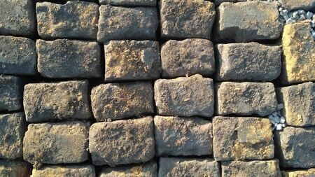 Stone pavement texture. Granite cobblestoned pavement background. Abstract background of old cobblestone pavement close-up. Prague. View from above. Close up Stockfoto
