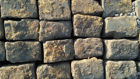 Textura de pavimento de piedra. Fondo de pavimento de adoquines de granito. Antecedentes del antiguo pavimento de adoquines de cerca. Praga. Vista desde arriba. Foto de archivo