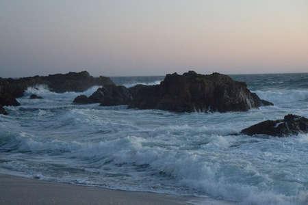 rough rocky ocean closeup at sunset Stock Photo