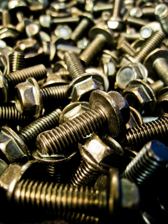 A lot of black steel bolts photo