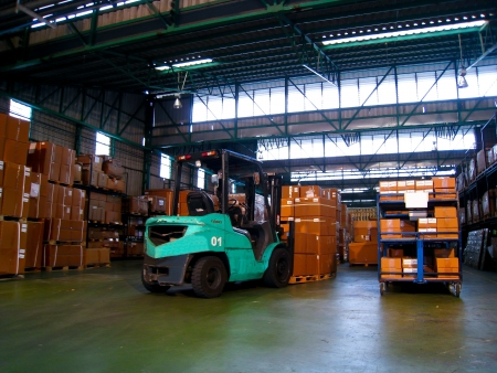 Green forklift in warehouse