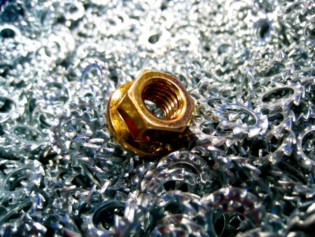 A brass nut on lots of star washer photo